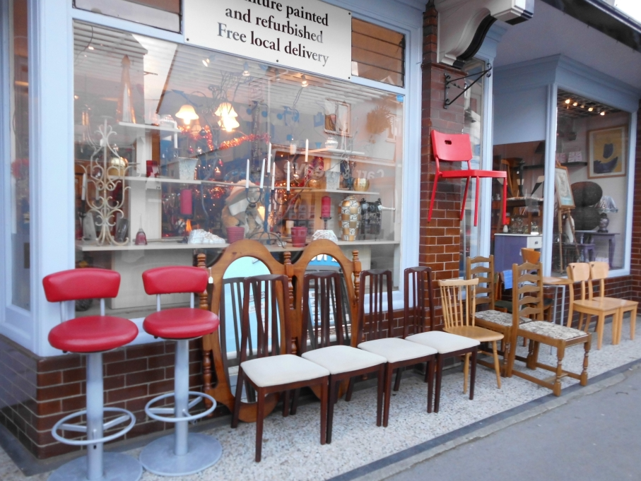 Antique chairs outside shop in Ringwood, Dorset - United Kingdom.